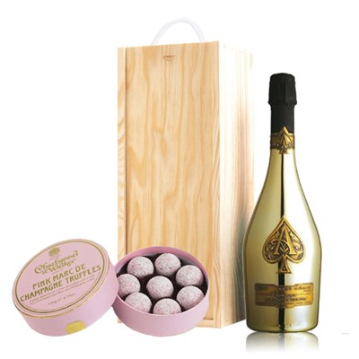 A single bottle of Armand de Brignac Gold 75cl, Champagne & Charbonnel  Pink Marc de Champagne Truffles (135g), Presented in a wooden gift box with sliding lid and lined with wood wool with a Gift Card for your personal message. . Price includes free UK Mainland Delivery, and Exports and international delivery available.